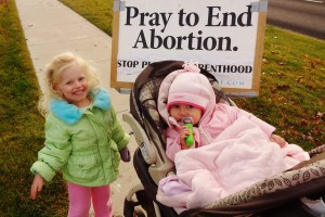 My daughters Charlie and Siena witnessing with me on the sidewalk in front of the new Meridian, Idaho Planned Parenthood Megacenter.  I tell Charlie that when the cars honk (happily) they are thanking her being there to pray for the babies.